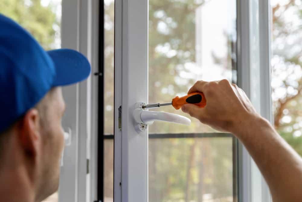 Locksmith fixing a uPVC window lock in Princes Risborough